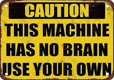 caution-this-machine-has-no-brain-use-yours-vintage-look-reproduction-metal-sign-5421b104d0ba27f886db83bff1eb67b9